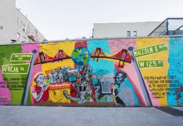 Harlem Mural depicting collaboration between Yuri Kochiyama and Malcom X